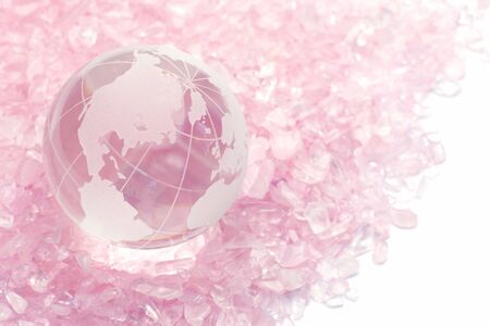 rose quartz: I put a terrestrial globe of the glass on rose quartz and took it  Stock Photo
