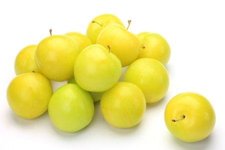 plural number: white plums in a white background.