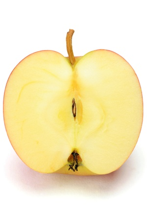 白い背景にリンゴを取った。