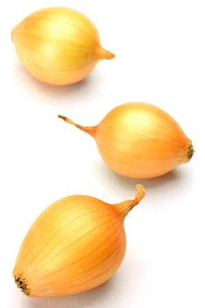 petit: three petit onions in a white background