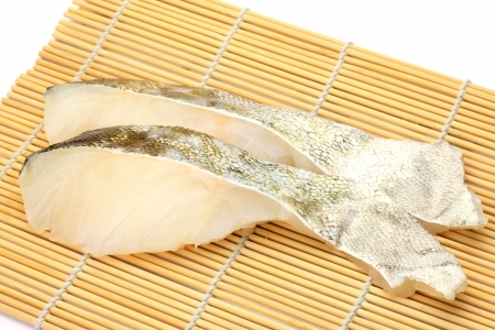 fishery products: I took two slices of cods on a bamboo blind. Stock Photo