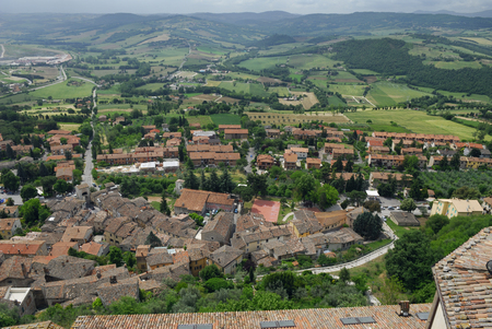 View of rooftops and pastureland hills from San Fortunato church in Todi Italy LANG_EVOIMAGES