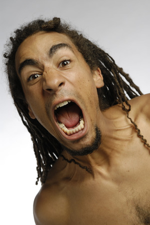 Black man with dreadlocks yelling and screaming