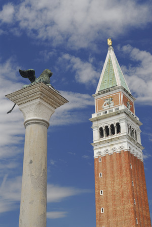 winged lion: Pedestal with winged lion and St Marks bell tower with tourists