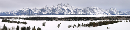 Wide panorama of the Grand Teton peaks in winter from Teton Point turnout Jackson Hole