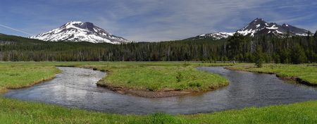 Panorama of Soda Creek at Sparks Lake meadow with South Sister and Broken Top mountains