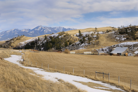 Pasture land and barn at Bozeman Pass on Old Boseman Hill Road Montana with Mount Delano of Absaroka Range LANG_EVOIMAGES