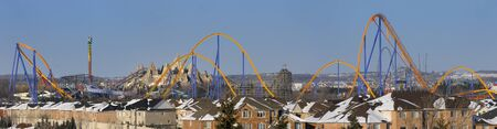 closed community: Panorama of a closed amusement park in winter next to a residential housing development near Toronto