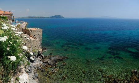 yarrow: Blue Mediterranean sea and cliffs of Talamone Italy