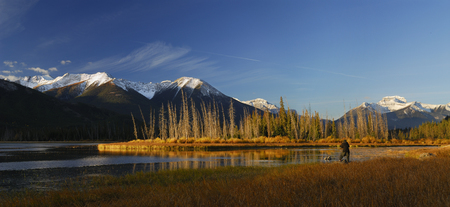 Panorama of photographer on First Vermilion Lake at sunrise in the Fall LANG_EVOIMAGES