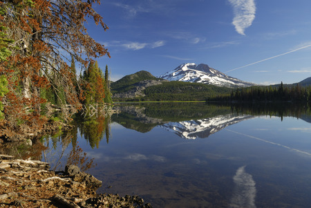Early morning on calm Sparks Lake with South Sister and treed shoreline