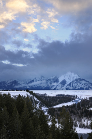 Grand Teton peaks and Snake River at sunset in winter from the Jackson Hole Overlook Wyoming LANG_EVOIMAGES