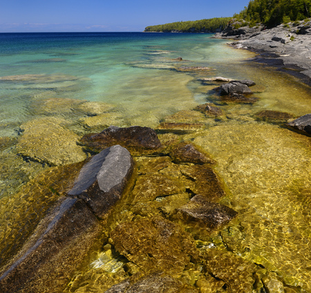 Clear clean water on the limestone shore of Little Cove Bruce Peninsula