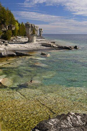 Seastacks and clear waters of Flowerpot Island Bruce Peninsula Canada
