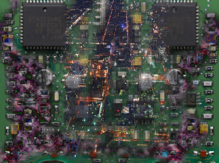 City lights at night overlayed onto microchips and electronic circuit board