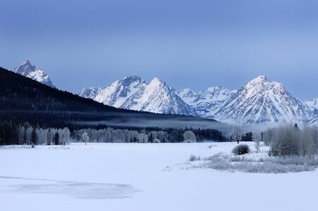 Frozen mist over Oxbow Bend on the Snake River with Grand Teton Peaks on a cold winter morning