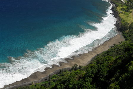 Black sand beach waves at Kalaupapa settlement on Molokai LANG_EVOIMAGES