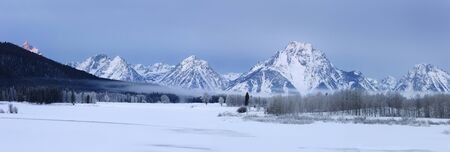 Panorama of mist and frost over Oxbow Bend on the Snake River with during cold winter morning