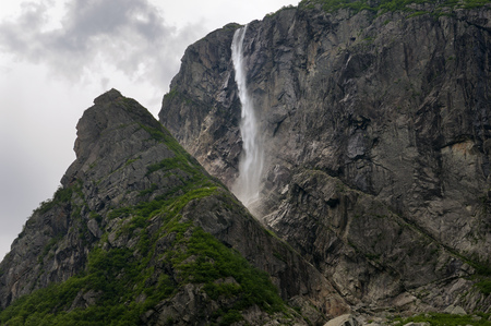 maritimes: Detail of Pissing Mare Falls at east end of Western Brook Pond with steep cliff fjords