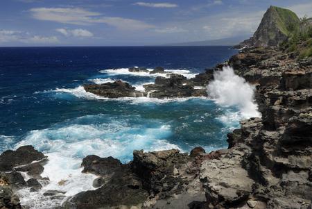 Crashing waves at Mokolea Point with Kahakaloa cinder cone LANG_EVOIMAGES