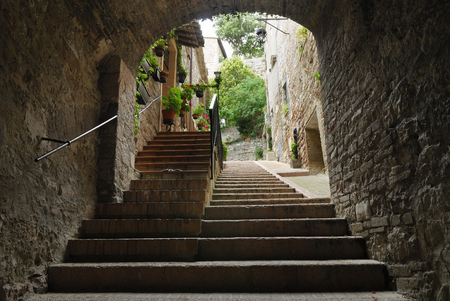 Steep hillside steps in a tunnel alleyway in Assisi Italy LANG_EVOIMAGES
