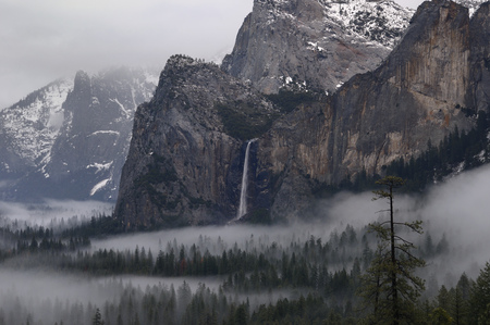 bridalveil fall: Bridalveil Fall emptying into clouds and fog after a winter storm