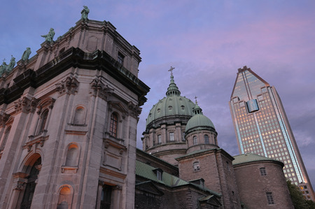 third world: Highrise with Green dome and facade of Mary Queen of the World Basilica Montreal LANG_EVOIMAGES
