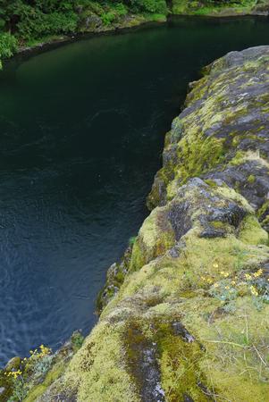 North Santiam river flowing around moss covered glacier eroded rocks LANG_EVOIMAGES