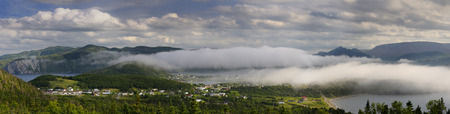 bonne: Panorama of low clouds over Bonne Bay in the evening