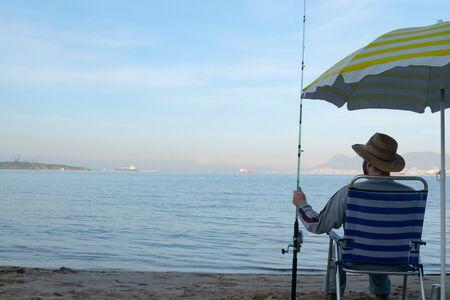 Man fishing on the seashore