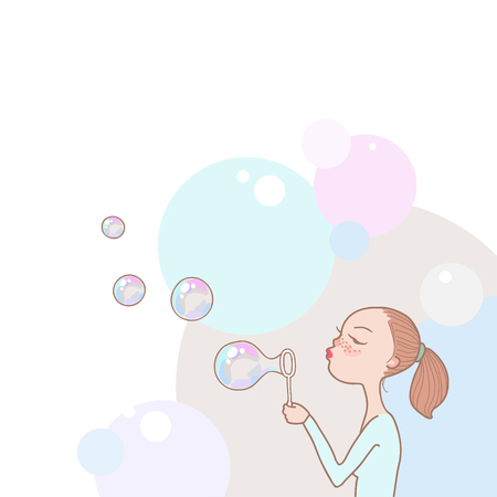 soap suds: Young redhead girl blowing soap bubbles