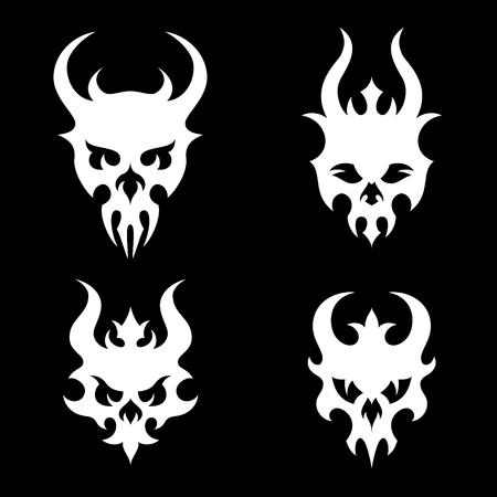 death metal: Set of stylized skulls with horns in tribal style. White illustration on black background Illustration