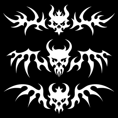 Set of stylized skulls with wings in tribal style. White illustration on black background