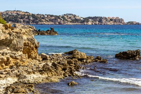 Rocky coast at Peguera in the west of Mallorca on a sunny day in spring