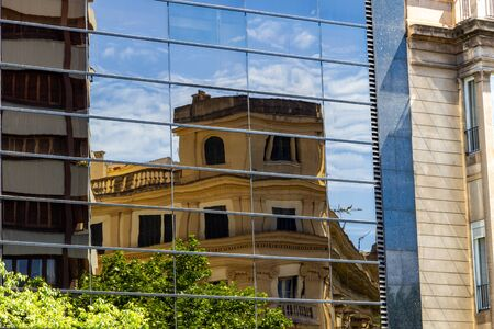 Reflection of an older building in  a window pane in Palma on balearic island Mallorca, Spain on a sunny day