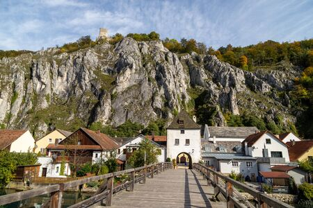 High rocks in the village Essing in Bavaria, Germany at the Altmuehl river on a sunny day in autumn with blue sky and white clouds