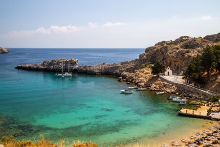 Scenic view at St. Pauls bay in Lindos on Rhodes island, Greece on a sunny day