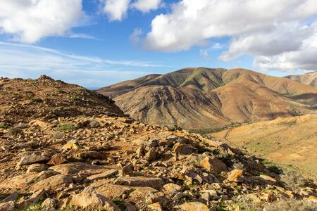 Panoramic view at landscape between Betancuria and Pajara on Fuerteventura, Spain with multi colored volcanic hills and mountains Reklamní fotografie