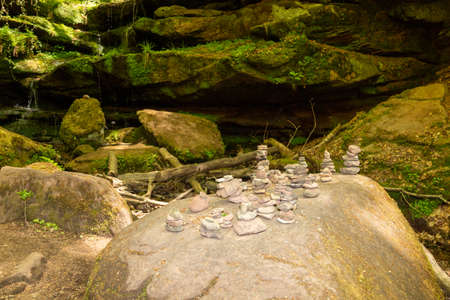 Rock formations and stone figures along the footpath Hexenklamm in the Palatinate forest