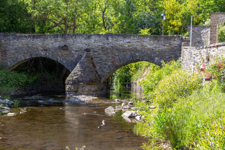 Historic stone bridge over river Elz in Monreal, Germany
