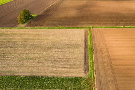 Agriculture with different small fields and arable land in Europe seen from above Standard-Bild
