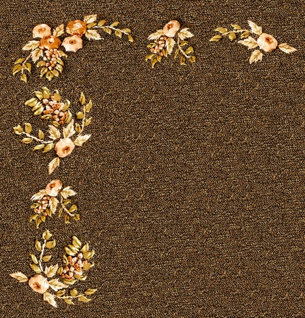 stockinet: flowers embroidered with multicolored ribbons on a knitted brown stockinet Stock Photo
