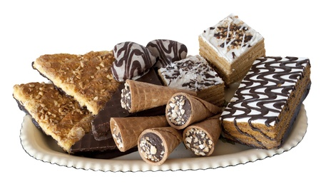 set of confectionery on a dish, waffles, cakes, cake, decorated with crumbs and fudge photo
