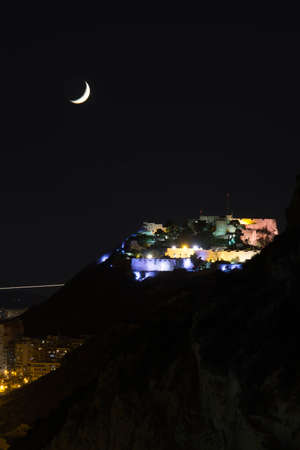 beautiful views of the city, beach and castle in the night, Spain 免版税图像