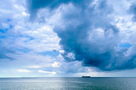 Beautiful cloudscape over a ship in the sea.