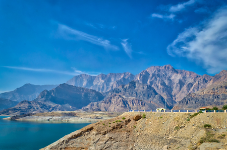Muscat landscape of mountains, blue sky and water. Peace and tranquility.