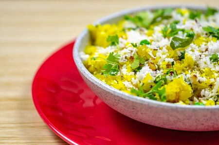 North Indian Food Poha in a bowl on a red plate