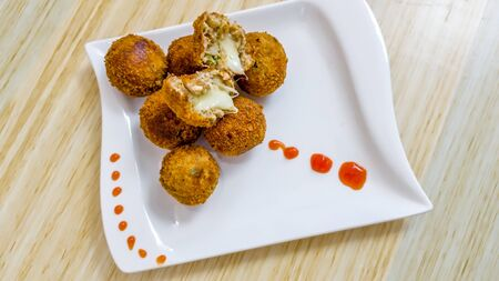 Close-up shot of fried cheese balls. Shot from above. Food photography
