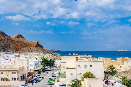Small, idyllic town at the foot of the hills and near the beach. From Muscat, Oman. Stock Photo
