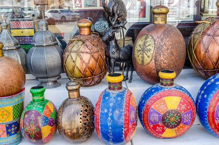 Traditional artistically painted colorful pots on display in shop in Muscat, Oman.